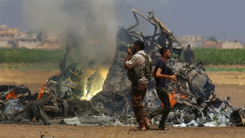 The wreckage of a Russian helicopter that had been shot down in the north of Syria's rebel-held Idlib province, August 1 [Reuters]