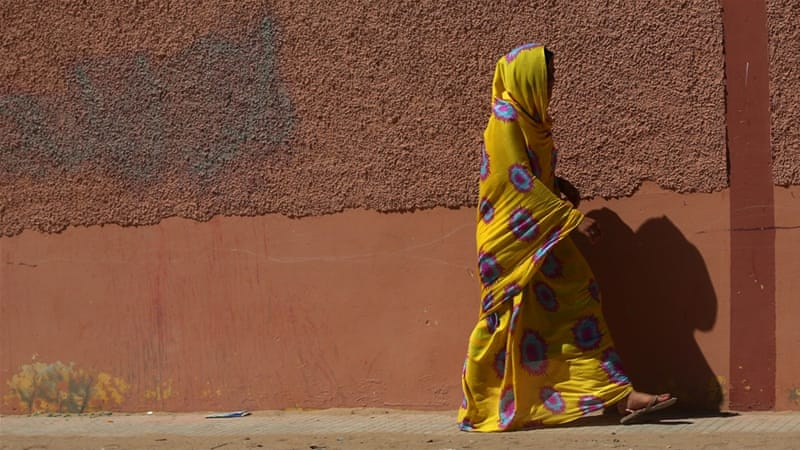 A woman walks in Laayoune, Western Sahara on May 7, 2013 [Getty]