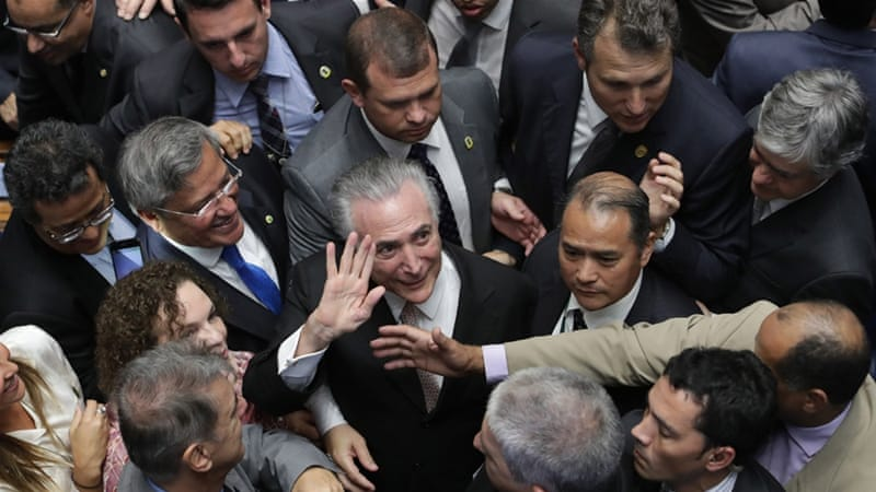 """Temer promised a """"new era"""" of government for Brazil [Eraldo Peres/AP]"""