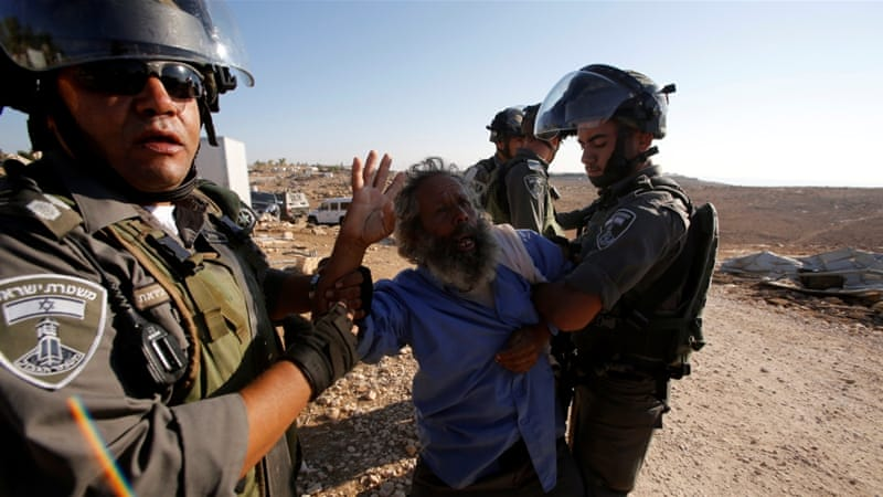 Israeli forces demolish five Palestinian Bedouin homes in the occupied West Bank [Mussa Qawasma/Reuters]