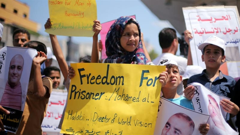 Palestinians and international NGO workers alike have dismissed the charges and called for Halabi's release [Reuters]