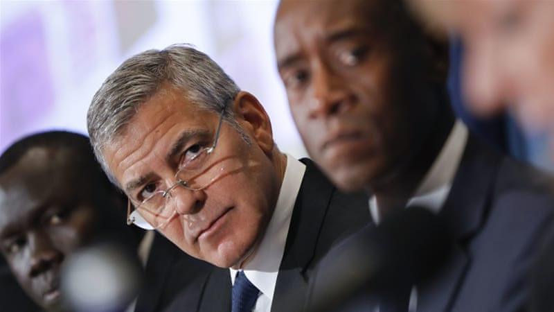 Hollywood actor George Clooney and other collaborators presented the project's findings [Pablo Martinez Monsivais/AP]