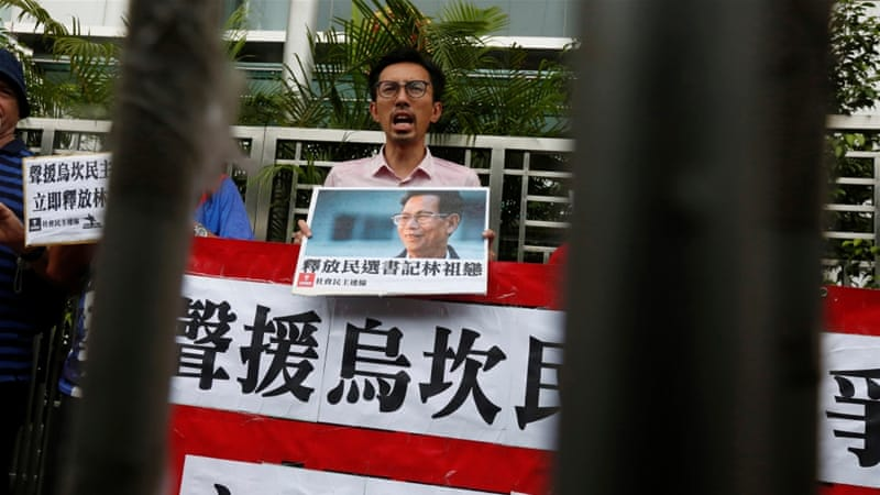 A protester against the jailing of Wukan village chief Lin Zulian in Hong Kong on September 9 [Bobby Yip/Reuters]