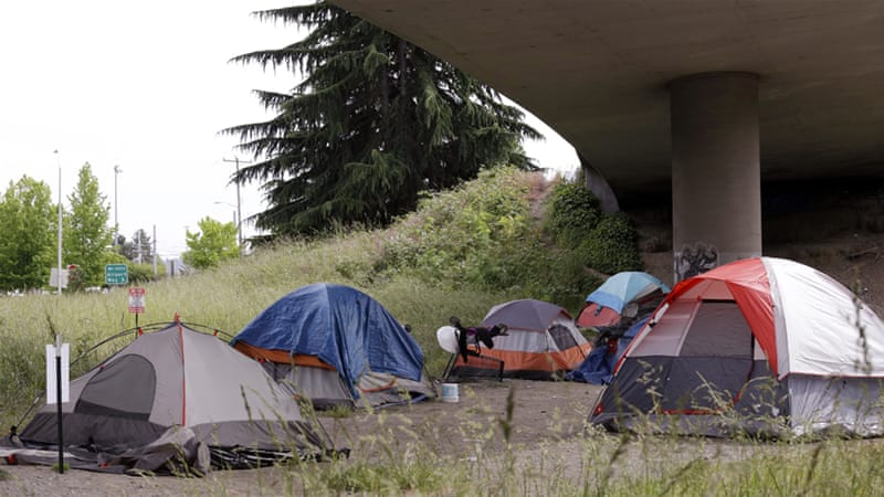 Tents belonging to the homeless under a Seattle highway near a larger enc&ment known the & Seattle struggles to deal with high homeless rate | USA News | Al ...