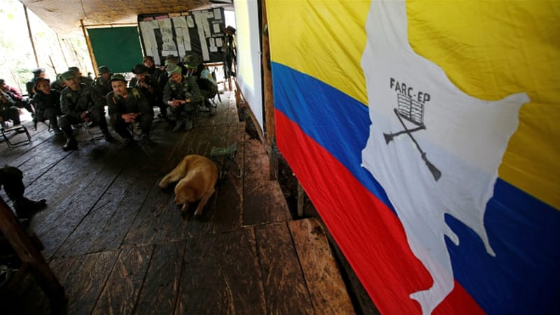 Members of the 51st Front of the FARC listen to a lecture on the peace process between the Colombian government and their force [Reuters]