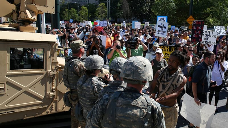 Charlotte residents march to protest against the police killing of Scott [Mike Blake/Reuters]