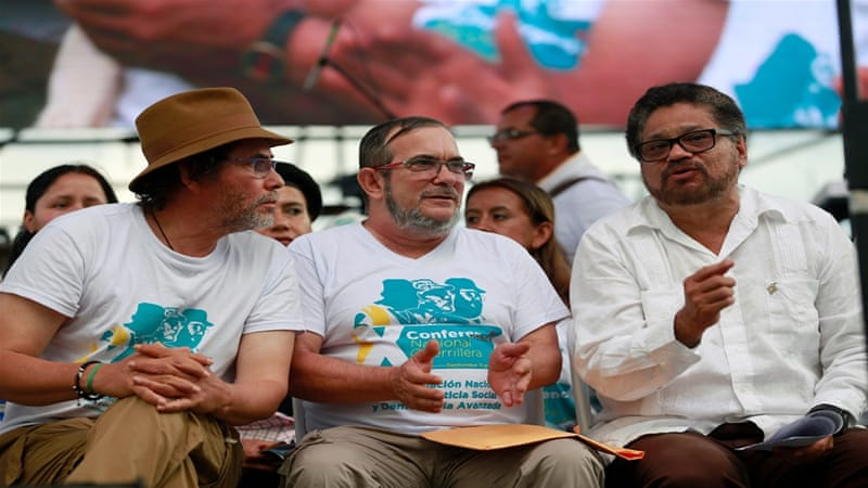 FARC rebel leader Timochenko (C) talks with Pastor Alape (L) and Ivan Marquez during the closing ceremony of a rebel congress [John Vizcaino/Reuters]