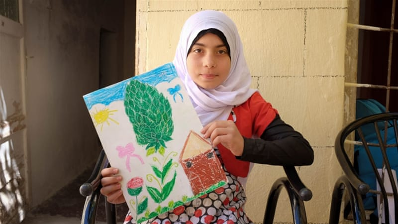 Rahaf Alewi holds up a pastel sketch of her village in Aleppo [Megan O'Toole/Al Jazeera]