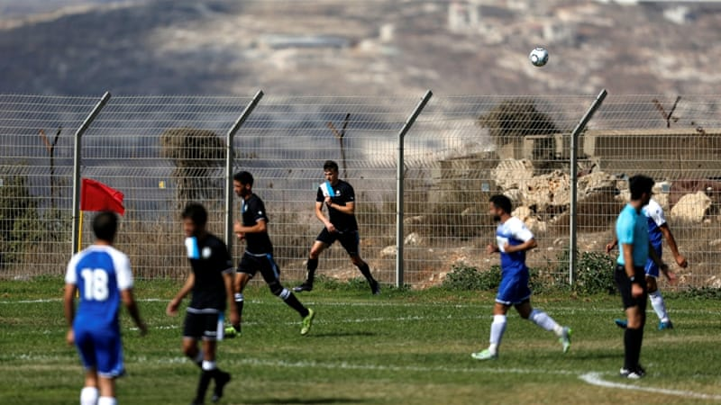 Ariel Municipal  plays Maccabi HaSharon Netanya at the former's training grounds in the Ariel settlement in the occupied West Bank [Amir Cohen/Reuters]