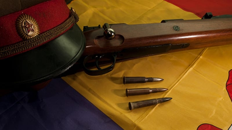 A Soviet cap, a rifle and a few bullets on a flag of the Spanish Republic [Getty]