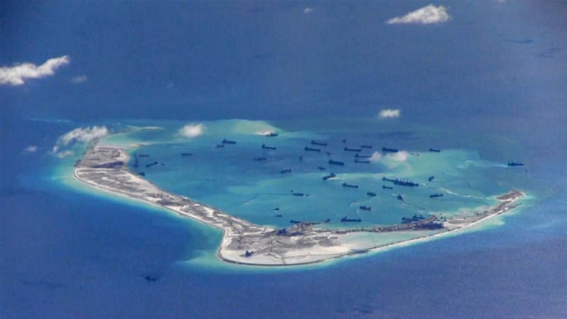 An artificial island would potentially give China a military base close to US forces [Reuters]