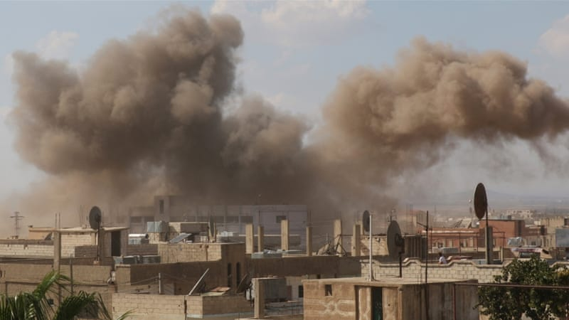 Smoke rises after an air strike in the rebel-held town of Dael, in Deraa Governorate, Syria [Reuters]