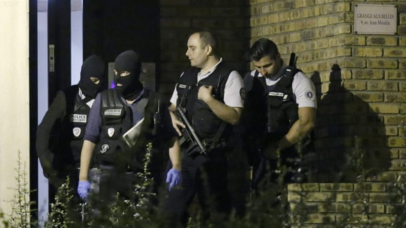 The apartments of the suspects have been raided since the arrests began on Tuesday [Reuters]