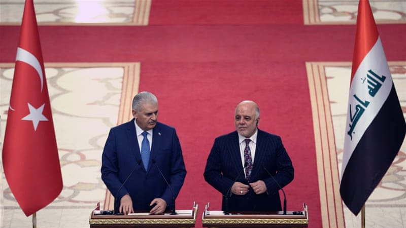 Abadi, right, wants Turkish forces to leave Bashiqa camp [File: Reuters/Handout]