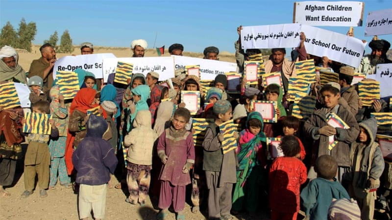 Afghan volunteers of Pen Path Civil Society hold placards during an educational awareness campaign in Kandahar, Afghanistan [EPA]