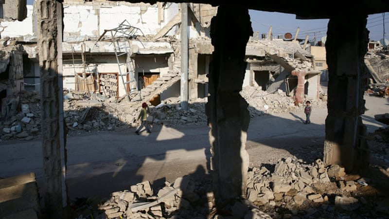 Damaged buildings in the rebel-held besieged city of Douma on the outskirts of Damascus [Bassam Khabieh/Reuters]