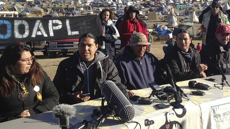 Organisers of protests against the construction of the Dakota Access Pipeline speak at a news conference near Cannon Ball, ND on November 26, 2016  [AP]