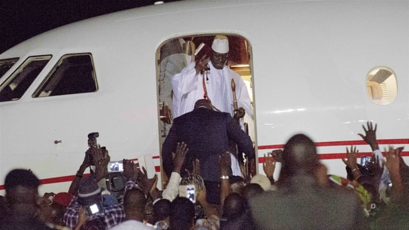 Gambia's defeated leader Yahya Jammeh waves to supporters as he departs at Banjul airport Saturday Jan 21, 2017 [AP]