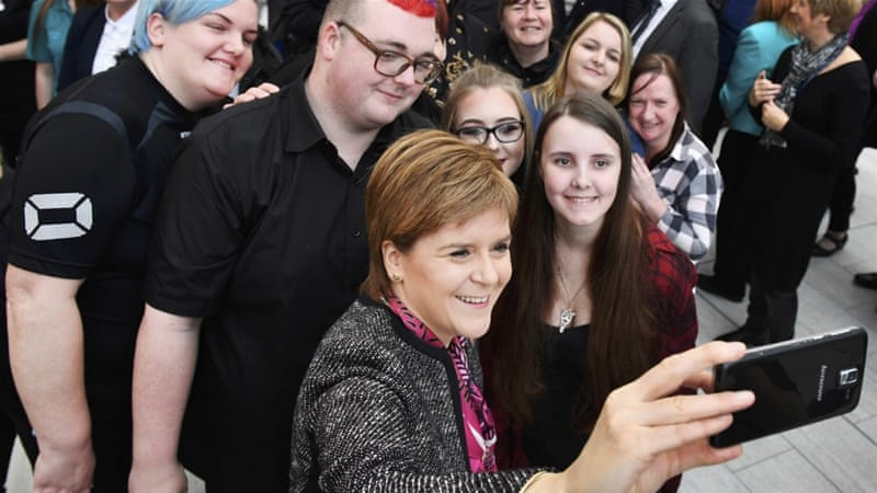 First Minister of Scotland Nicola Sturgeon takes a selfie with students as she officially opens the revamped Kilmarnock campus of Ayrshire College in Kilmarnock, Scotland, December 12, 2016 [Reuters]
