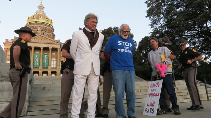 Reverend Billy getting arrested during an anti-Monsanto protest in Des Moines, Iowa in 2016 [Sharon Donovan/Al Jazeera]
