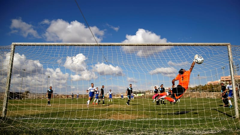 Ariel Municipal Football Club plays Maccabi HaSharon Netanya Club at the former's training grounds in the West Bank Jewish settlement of Ariel [Reuters]