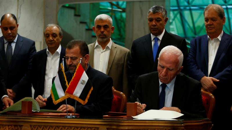 Hamas delegation chief Saleh Arouri and Fatah leader Azzam Ahmad signed a reconciliation deal in Cairo in October [Reuters]