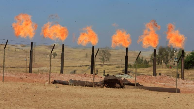 Flames emerge from flare stacks at the oil fields in Dibis area on the outskirts of Kirkuk, Iraq October 17, 2017 [Alaa Al-Marjani /Reuters]