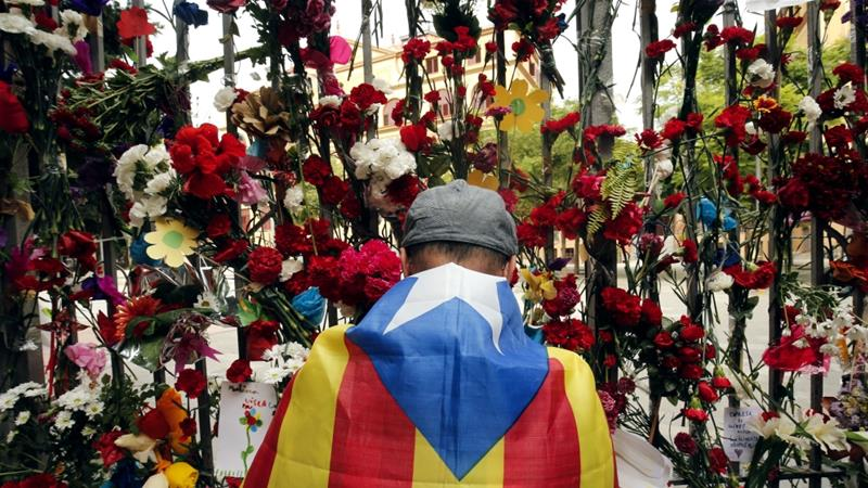 People placed flowers outside polling stations, which had been sites of violent clashes during the vote [Pau Barrena/AFP]