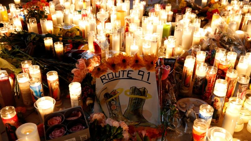 Candles are pictured on the Las Vegas strip following a mass shooting at the Route 91 Harvest Country Music Festival in Las Vegas, Nevada [File: Chris Wattie/Reuters]