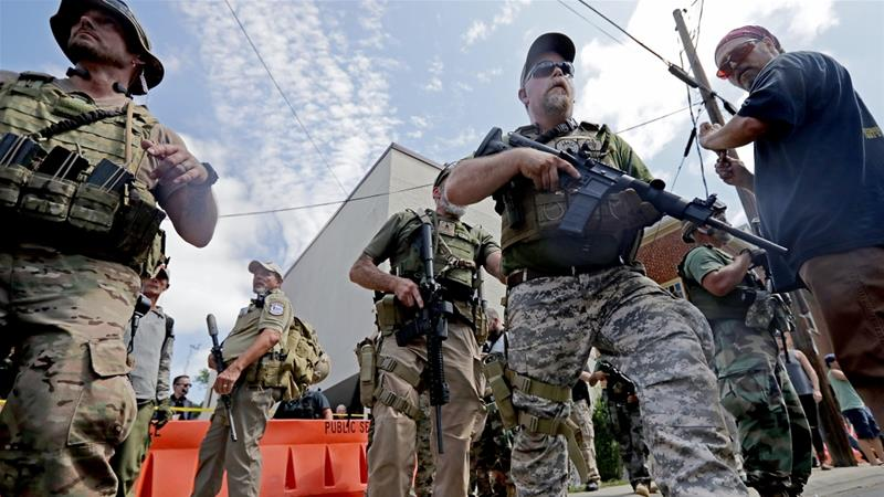 Militia groups have regularly attended far-right rallies in recent years [File: Chip Somodevilla/Getty Images]