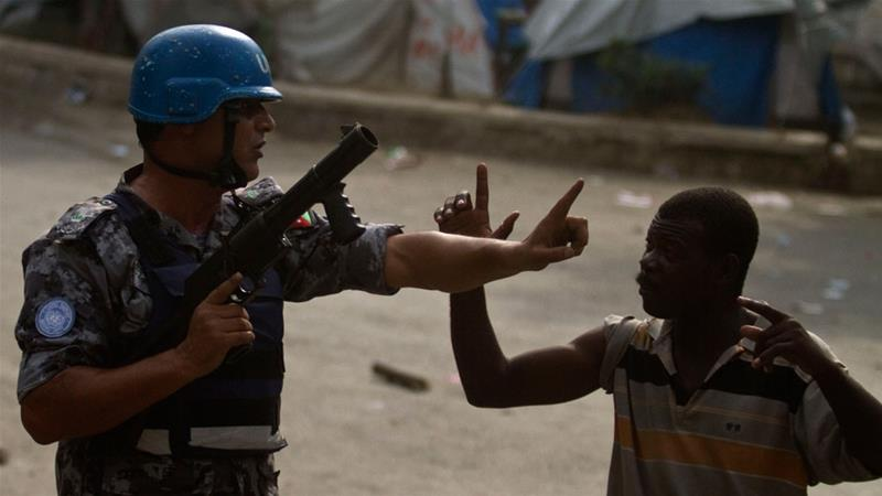 A UN peacekeeper argues with a supporters of 2010 presidential candidate Michel Martelly in Port-au-Prince [File: Gulliermo Arias/AP Photo]