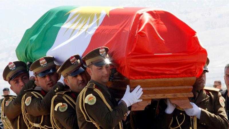 The coffin of former Iraqi President Talabani was covered with a Kurdish flag at Sulaimaniyah Airport