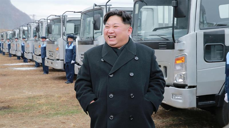 North Korean leader Kim Jong-un inspects a vehicle plant in this undated photo [KCNA via Reuters]