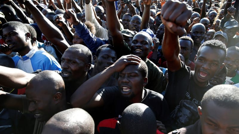 People gesture during a commemoration of the lives of opposition supporters killed during confrontations with the security forces over the election period in Nairobi [Baz Ratner/Reuters]