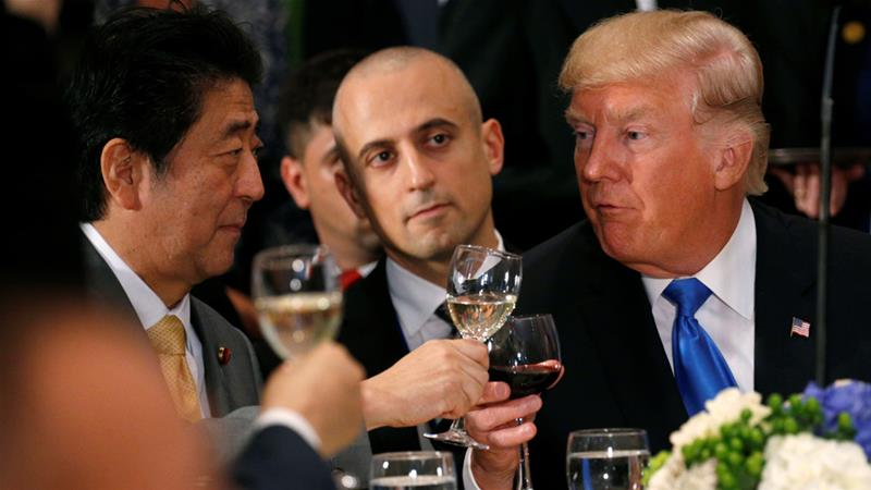 Prime Minister Shinzo Abe, left, toasts with Donald Trump at a luncheon in New York City in September [Kevin Lamarque/Reuters]