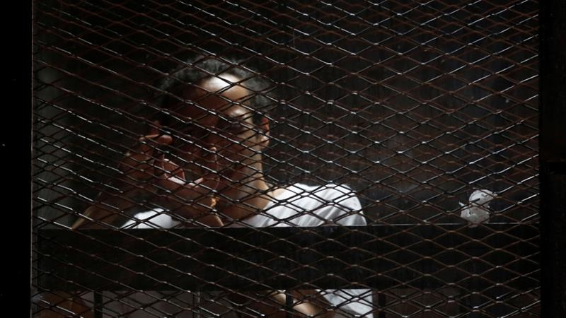Zeid, who is also known as Shawkan, was accused of 'murder and membership of a terrorist organisation' [Reuters]