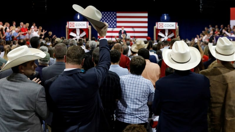 A supporter raises his cowboy hat as US President Donald Trump speaks about tax reform during a visit to Loren Cook Company in Springfield, Missouri, US [Kevin Lamarque/Reuters]