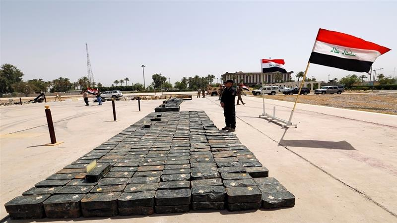 Iraqi security forces display weapons confiscated from ISIL fighters [Wissm Al-Okili/Reuters]