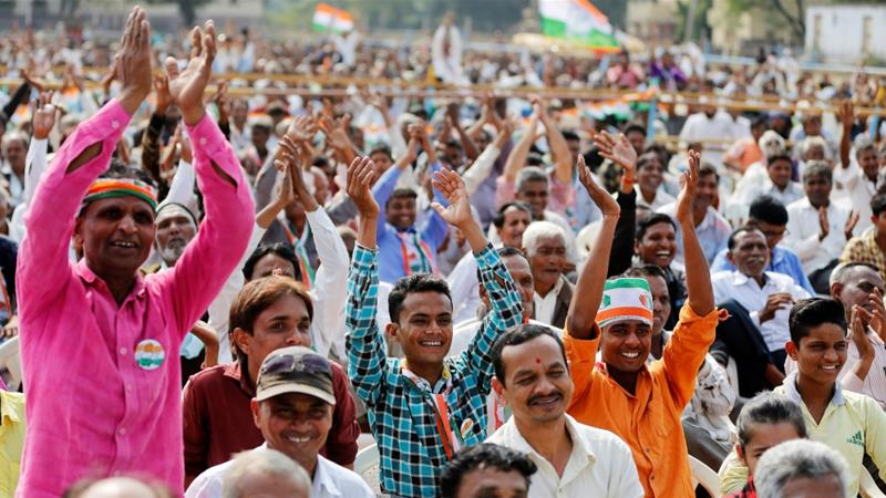 Supporters of India's main opposition Congress party cheer for Rahul Gandhi during an election campaign meeting ahead of the second phase of Gujarat state assembly elections [Amit Dave/Reuters]