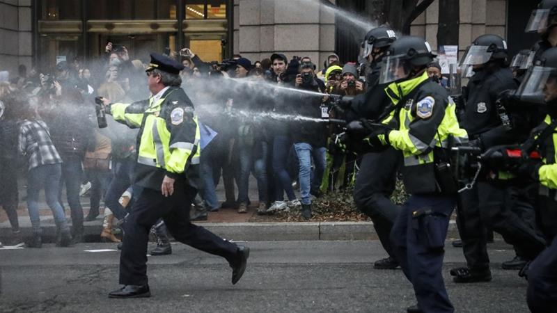 Police fire pepper spray at those protesting against the inauguration of Donald Trump