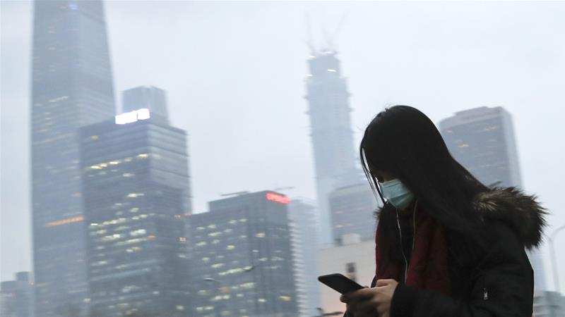 China, the world's largest producer of climate-warming greenhouse gases, has pledged to bring its carbon emissions to a peak by about 2030 as part of the global effort to curb rising temperatures [File: Andy Wong/AP]