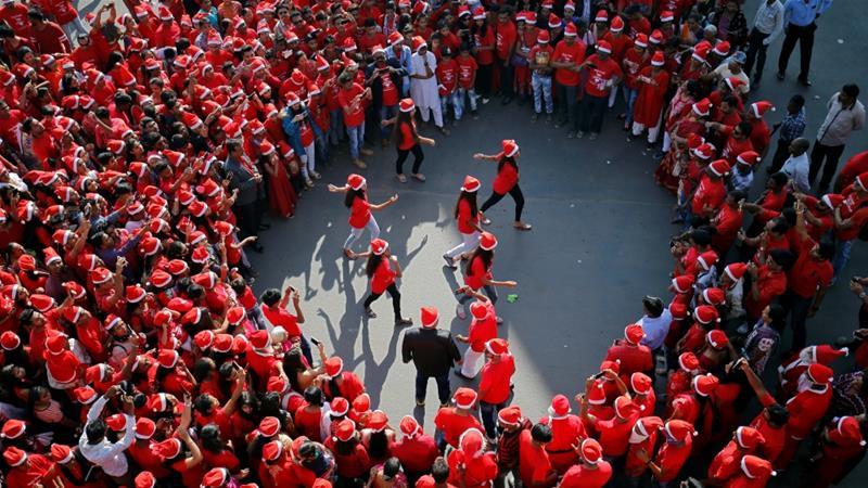 participants wearing santa claus caps perform during a christmas parade in ahmedabad india amit