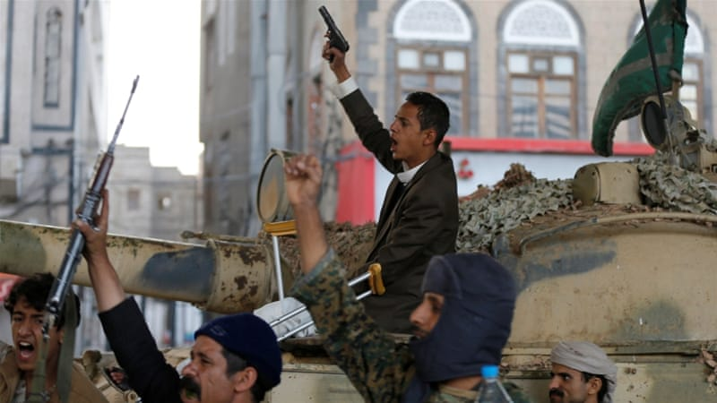 Houthis react as they gather next to a tank after the death of Yemen's former president, Ali Abdullah Saleh, in Sanaa [Khaled Abdullah/Reuters]