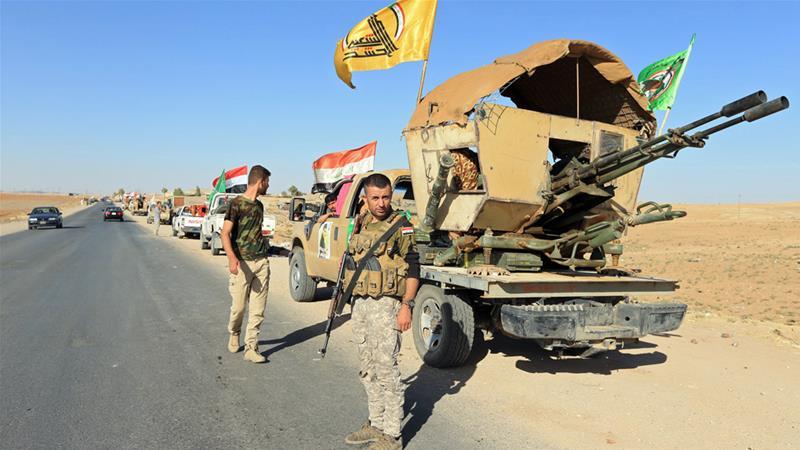 Roughly 63 factions make up Iraq's Popular Mobilisation Forces [Ari Jalal/Reuters]