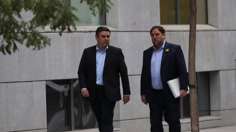 Oriol Junqueras (right) was charged with rebellion, sedition, and misuse of public funds [Susana Vera/Reuters]