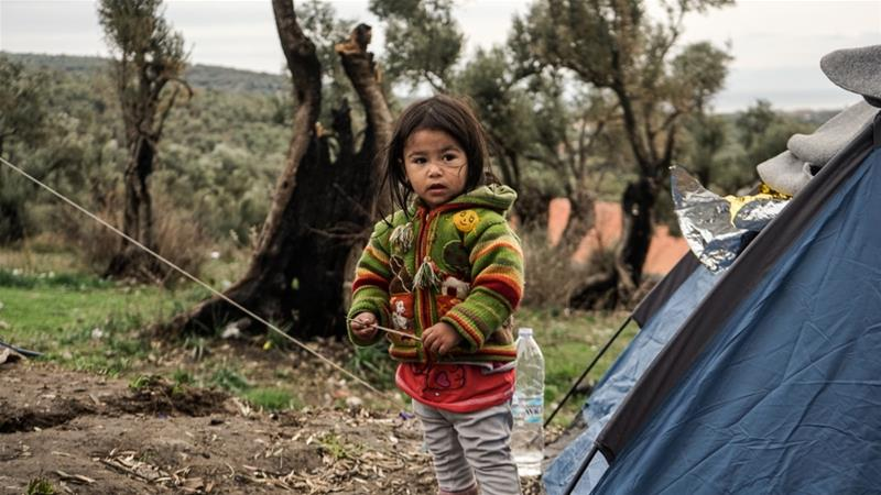 Refugees in Greece's Lesbos left in the cold and rain