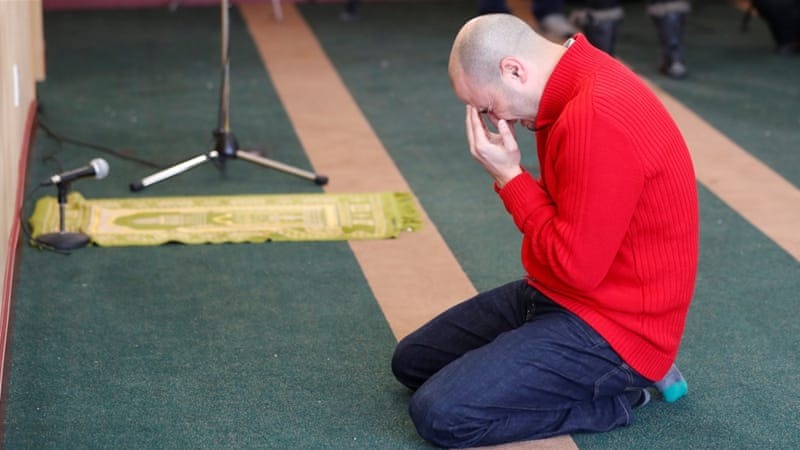 A man cries while he prays at the Quebec Islamic Cultural Centre where Bissonnette killed six people [Mathieu Belanger/Reuters]