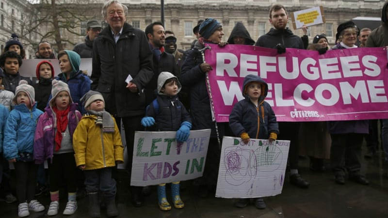 Labour peer Alfred Dubs, second row fourth left, poses with protesters before delivering a petition to Number 10 Downing Street in London, on February 11 [Neil Hall/Reuters]