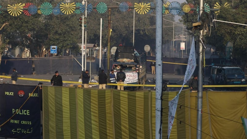 Pakistani security officials inspect the scene a day after a suicide bomb blast in Lahore [EPA]