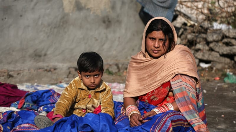 Hemlata, 29-year-old shawl cutter, 'Did those with black money sleep on an empty stomach?' [Showkat Shafi/Al Jazeera]